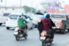 Car and motorcycle driving on road with traffic jam in the city, abstract blurr Stock Photos
