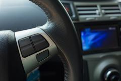 Blank button control system on car steering wheel used for placed icon Stock Photos