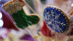 Souvenir cookies decorated with winter ornament, retail trade at Christmas fair Stock Footage