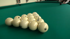 The cue ball rolls pyramid Russian billiards, leaving the cue ball makes several - stock footage
