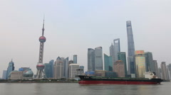 Shanghai, China city skyline with a big boat passing by - stock footage