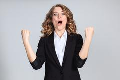 Stock Photo of The young woman's portrait with happy emotions