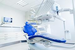 interior of new modern dental clinic office - stock photo