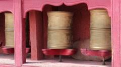 Buddhist prayer wheels in Tiksey monastery with written mantra. India,  Ladakh - stock footage
