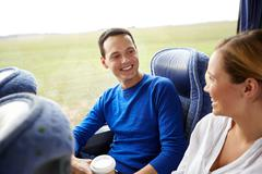 group of happy passengers in travel bus - stock photo