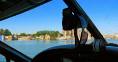 4K Cockpit of Seaplane Taxi on Water in City Harbor, Pilot Grabs Sunglasses,  - stock footage