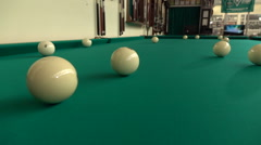 As a result of hitting the cue ball touches the neighboring and that starts to Stock Footage