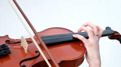 Beautiful girl playing violin Stock Footage