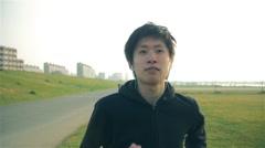 inspirational Japanese runner man runs toward camera steadycam shot - stock footage