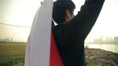 Inspiring Yuong Japanese man holds his flag high after running feeling proud - stock footage