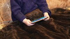 little boy watching cartoon on a smartphone indoor - stock footage