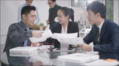 4K Corporate business group in a meeting with businessmen shaking hands in foreg - stock footage