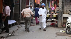 Indian people in a narrow street during traffic, Amritsar. India Stock Footage