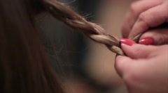 making braid hairstyle - stock footage