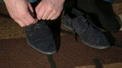 Men tying suede shoes laces Stock Footage