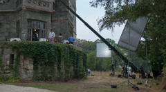 The people prepare to shot the film scene with a house. Time lapse. Wide angle Stock Footage
