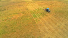 Stock Video Footage of Aerial of tractor on vast field in Discovery Bay