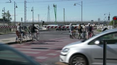 Cyclists waiting at the level crossing Stock Footage