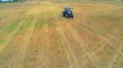 Aerial of tractor on vast field in Discovery Bay Stock Footage