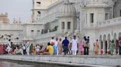 Stock Video Footage of Sikhs and indian people visiting the Golden Temple in Amritsar, Punjab, India.