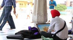 Indian students draws from nature the image of the Sikh Golden Temple, India Stock Footage