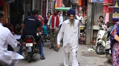 Indian people in a narrow street during traffic, Amritsar. India - stock footage