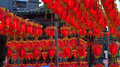 Thousand of Chinese red lanterns. Illuminate lamps to celebrate Chinese New Year Stock Footage