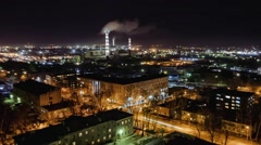 Cityscape with thermal power plant at night, time lapse, Russia Stock Footage