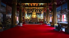 February 2016. Chiang Mai, Thailand. People praying to Buddha in Wat Phan On Stock Footage
