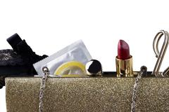 Condom and lipstick Stock Photos