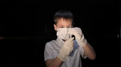 Child in a mask holding a syringe Stock Footage