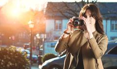 Tourist taking analog photograph Stock Photos