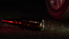 Drinking and Driving - Beer Bottle and Car Tire Abstract Concept - stock footage