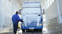 An employee cleans the truck at the car wash Stock Footage