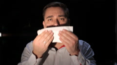 Man Sneezes Into A Tissue Stock Footage