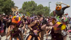 dancing people in a   Colorful street parade - stock footage