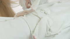 Masseuse put off white mitten from woman hand in beauty saloon. Thermo hand mask - stock footage