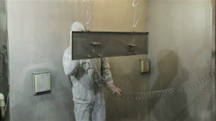 Woker in protect suit painting powder - stock footage