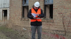 Building inspector checking documentation Stock Footage
