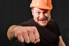 Dissatisfied foreman in safety helmet Stock Photos