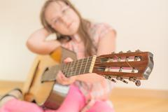 Girl with russian seven-string acoustic guitar Stock Photos