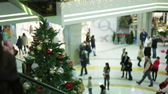 Atmosphere in shopping mall before winter holidays, people buying presents Stock Footage