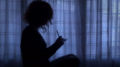 Lonely young woman writes an entry in her secret diary Stock Footage