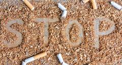 Stop smoking background with tobacco and cigarettes Stock Photos