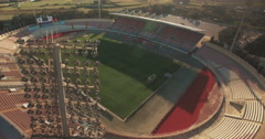Aerial shot - Tilting down on a European Football Soccer Stadium Stock Footage
