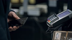 MOSCOW, RUSSIA - Contactless payment with your smartphone Stock Footage