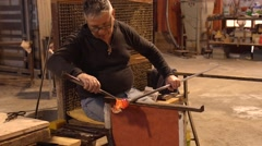 VENICE, ITALY - FEB 5, 2016: Glass blower crafts a glass horse in Murano, Venice Stock Footage