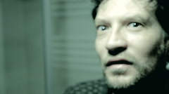 Man with dilate pupils after taking drugs looking in camera crazy feeling sick Stock Footage
