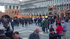 VENICE - FEB 6 2016:  Pan of Saint Mark's Square with walking tourists during Stock Footage