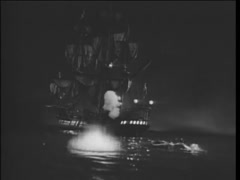 17th century reenactment of ship firing into open sea at night - stock footage